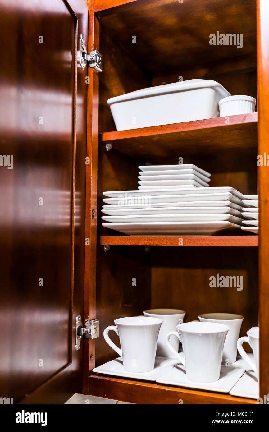 open cabinet door. Simple Open Open Wooden Kitchen Cabinet Door Cupboard With Many White Dishes Plates  Cups On Shelves Closeup In Cabinet Door