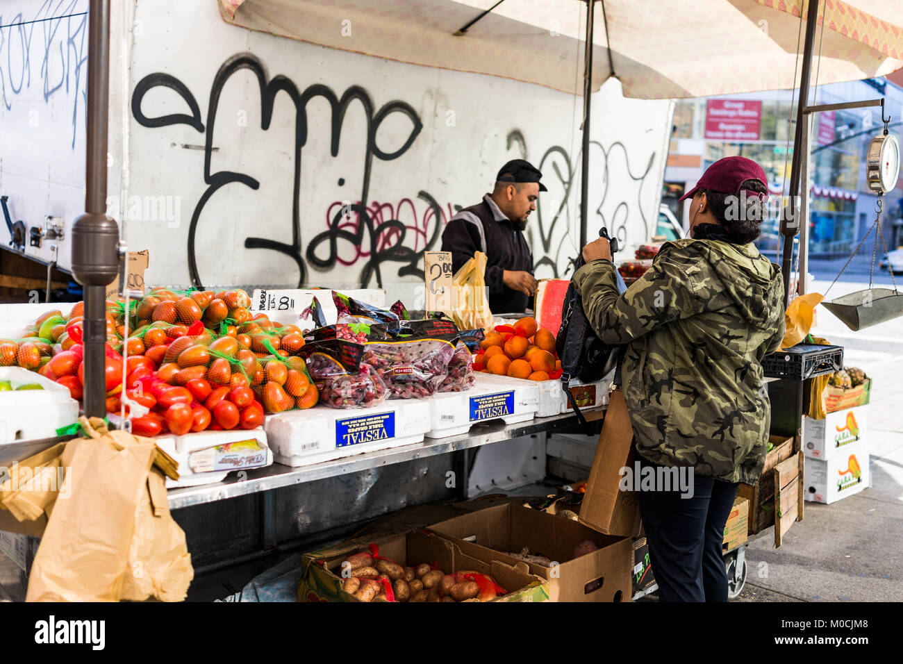 Bronx, USA - October 28, 2017: Cheap fruit stand food display market shop sale display in Fordham Heights center, - Stock Image