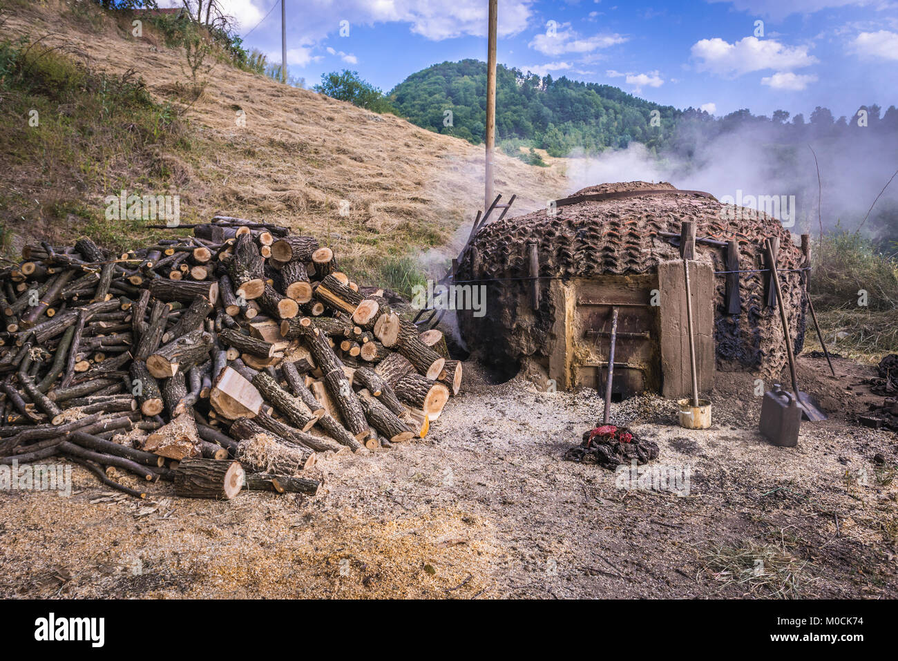 Traditional method of charcoal production method in Lucani municipality, Moravica District of Serbia - Stock Image