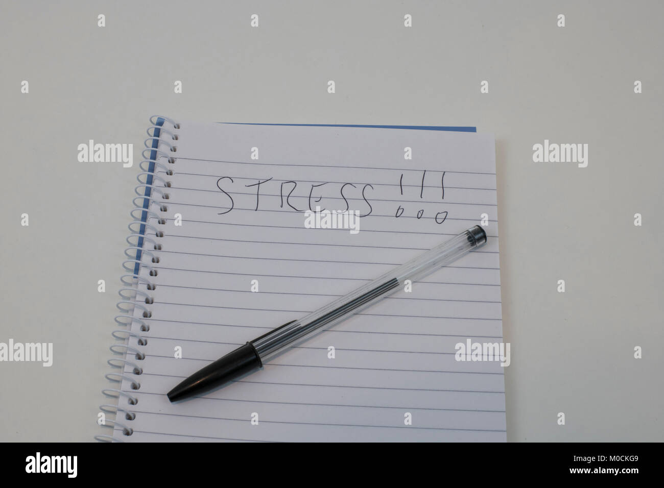 Handwriten Stress on notepad - Stock Image