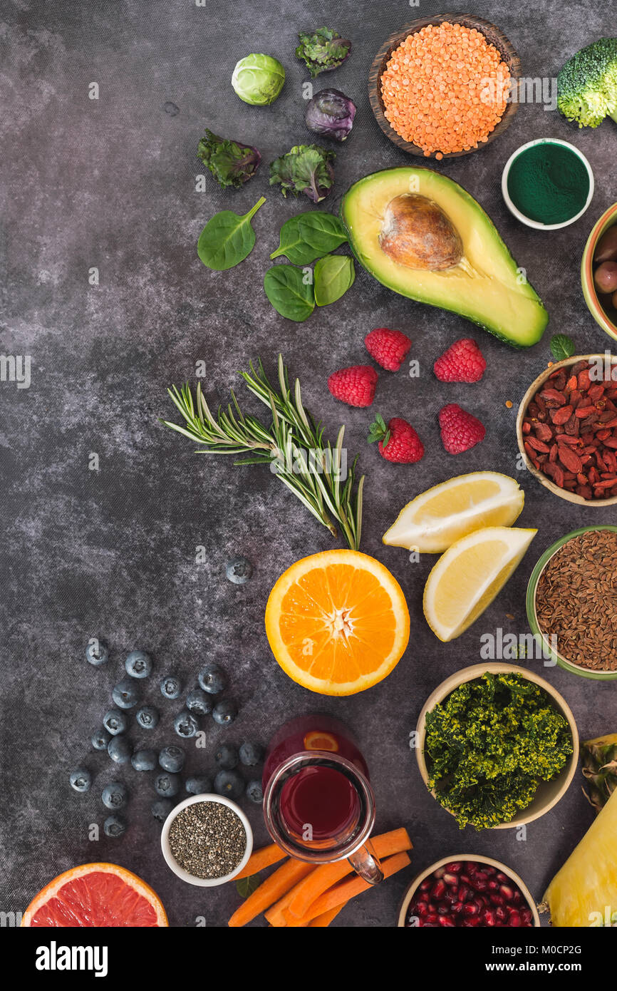 Superfoods. An arrangement of superfoods featuring seeds, legumes, fruits and vegetable. Top view, blank space, - Stock Image