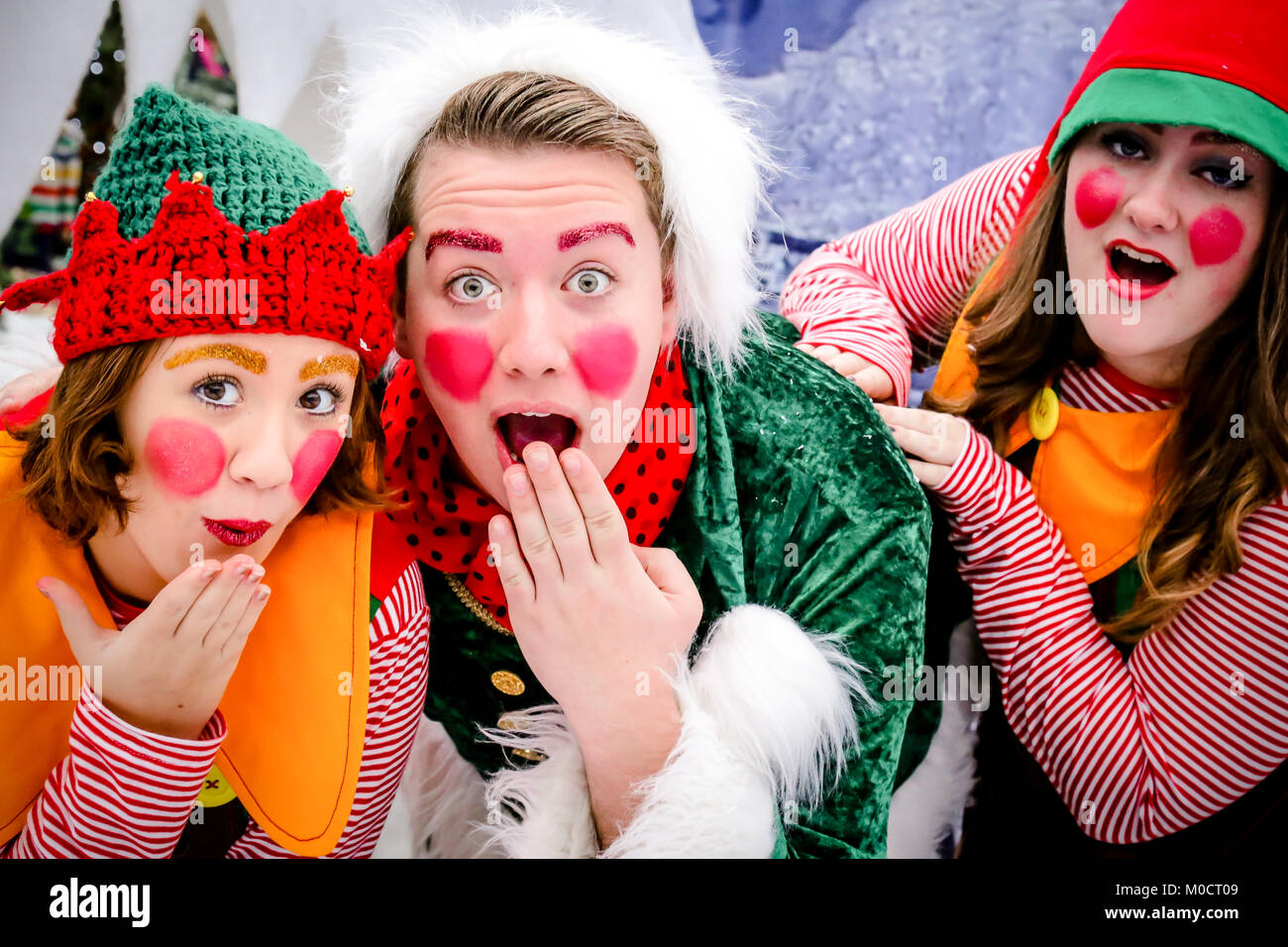Christmas 'elves' at a Santa's grotto event - Stock Image