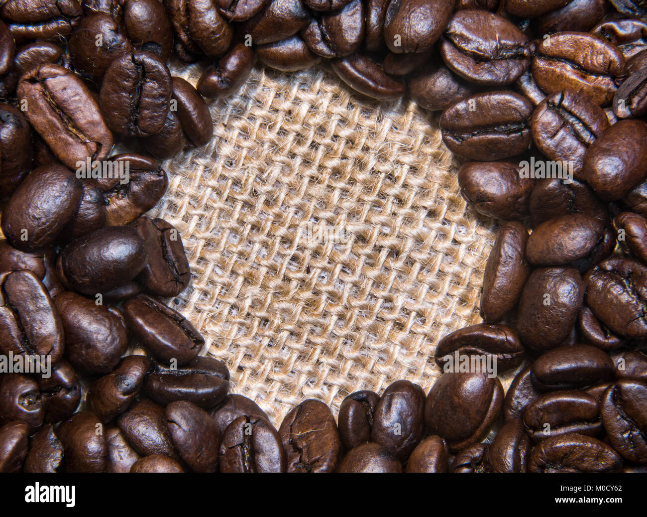 Roasted Coffee Beans on a Burlap Cloth Awaiting Your Words Stock Photo