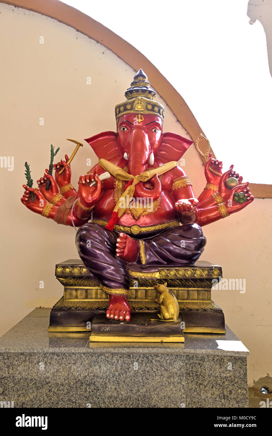 This is Number 2 of 32 miniature Ganesh statues in the circular hall under the large pink elephant building of Wat - Stock Image