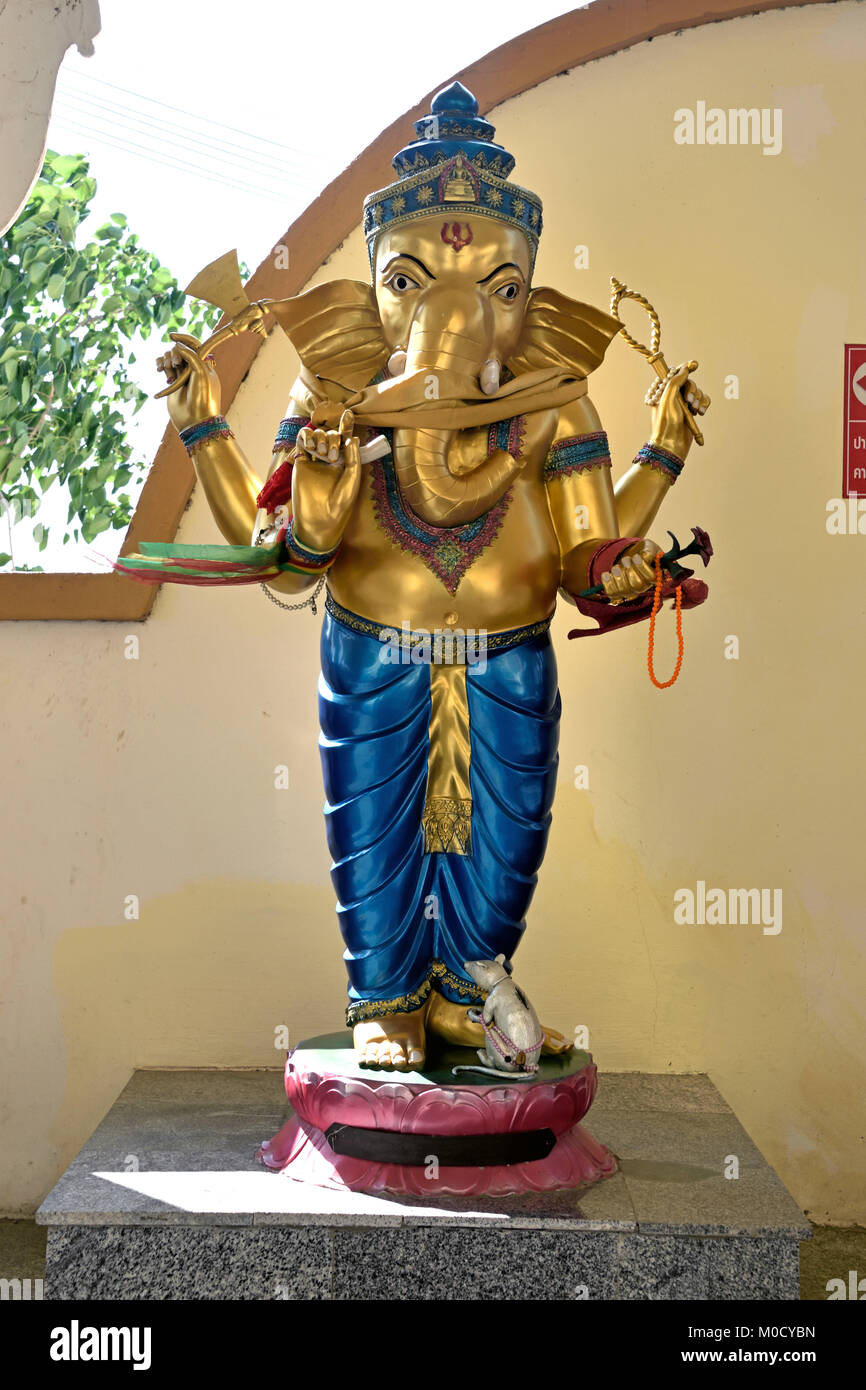 This is Number 9 of 32 miniature Ganesh statues in the circular hall under the large pink elephant building of Wat - Stock Image