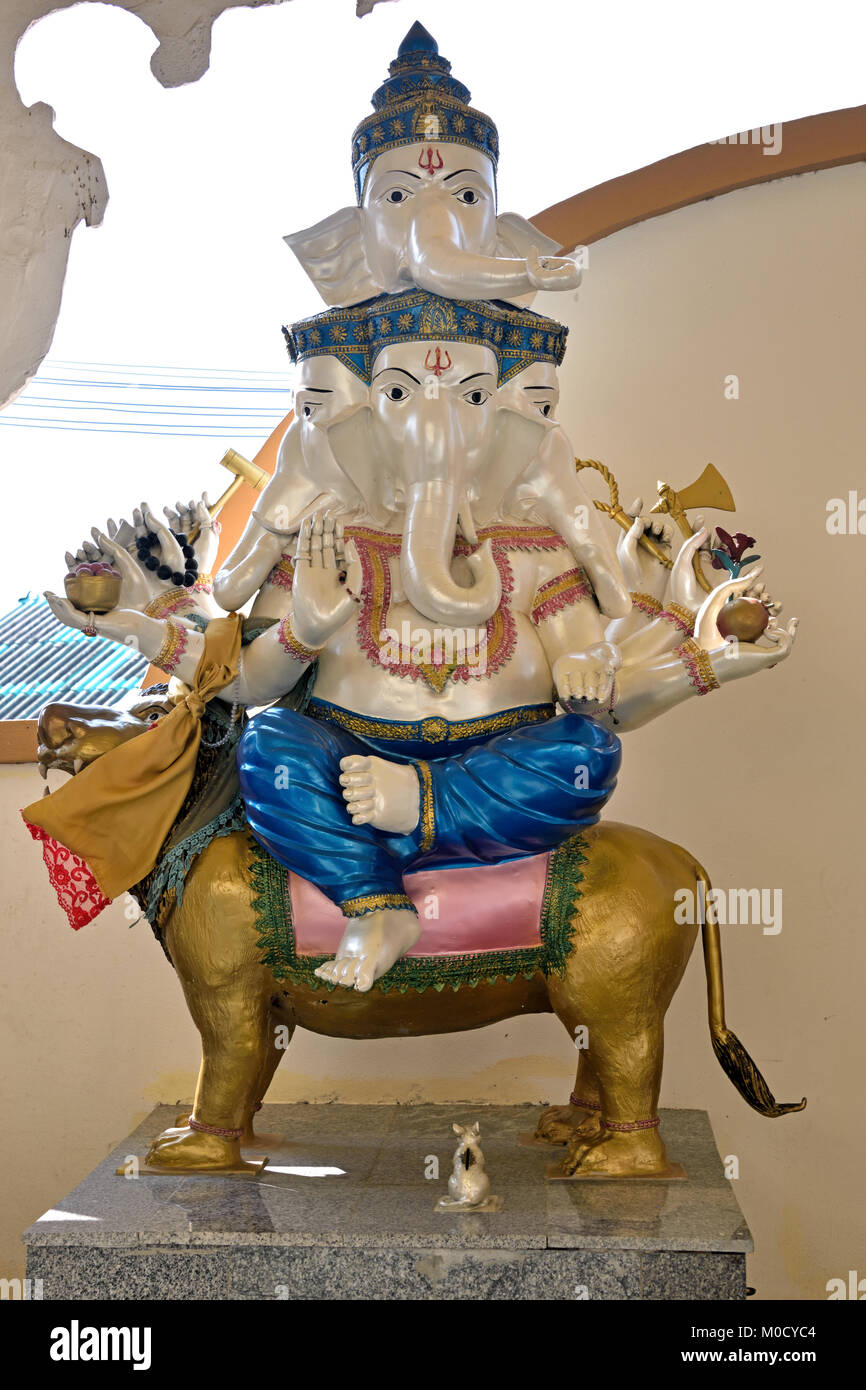 This is Number 11 of 32 miniature Ganesh statues in the circular hall under the large pink elephant building of - Stock Image