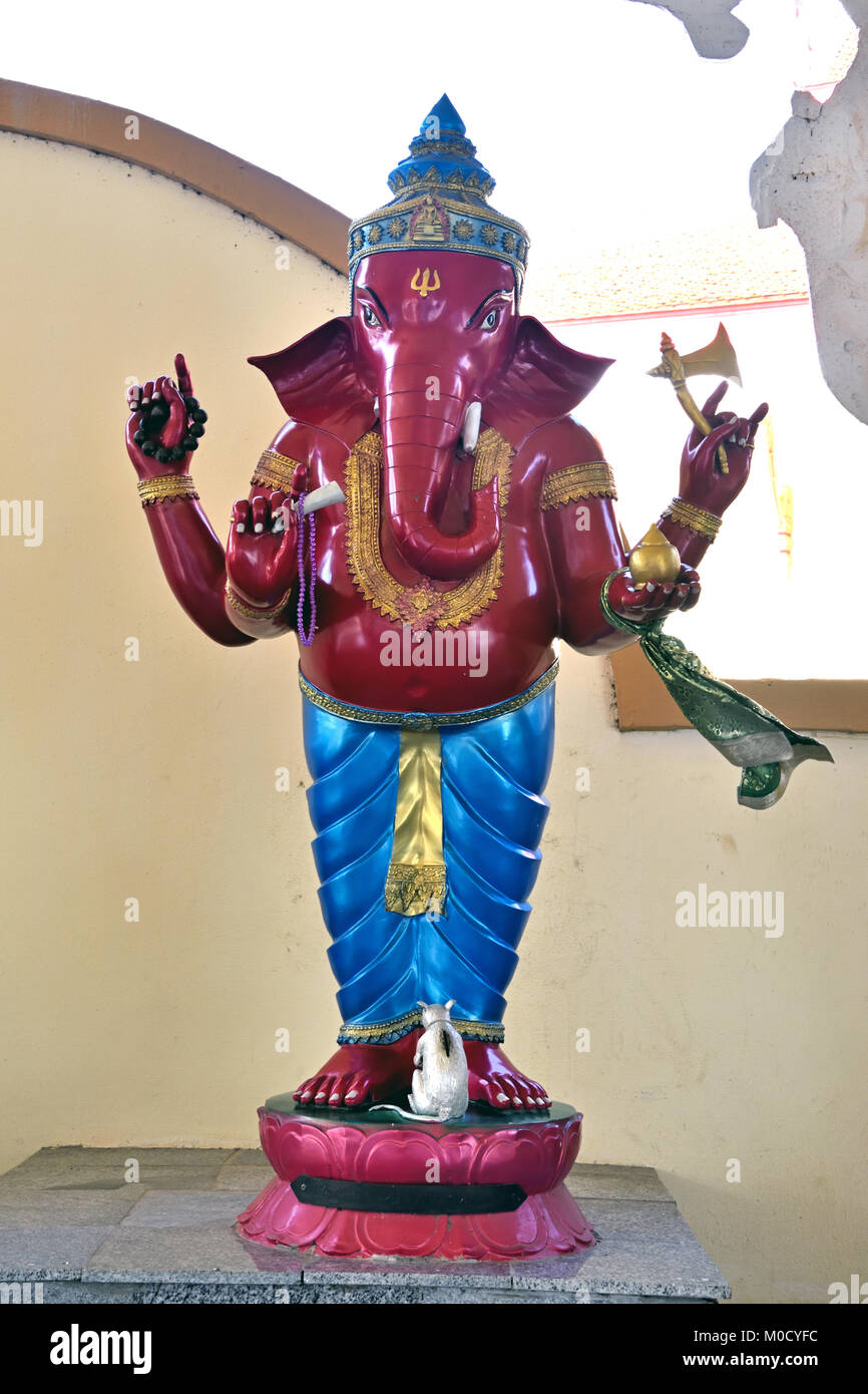 This is Number 26 of 32 miniature Ganesh statues in the circular hall under the large pink elephant building of - Stock Image