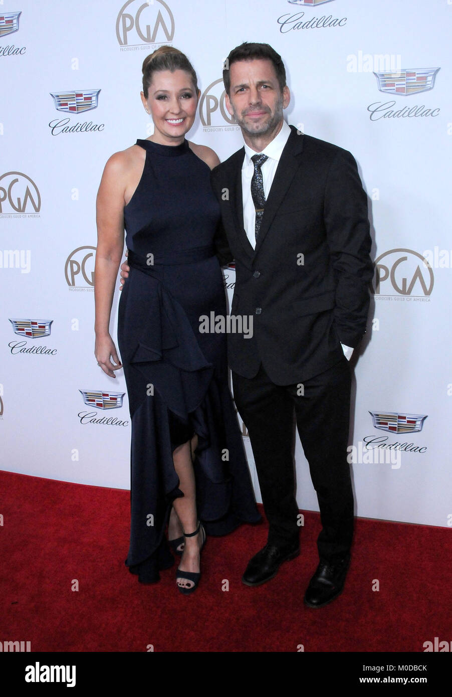 BEVERLY HILLS, CA - JANUARY 20: Director Zack Snyder (R) and wife Deborah Snyder (L) attend the 2018 Annual Producers - Stock Image