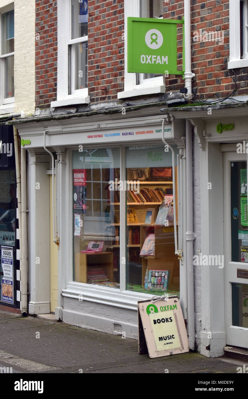 an Oxfam charity shop in a town centre selling records and books to make money for the oxford famine charity. Donations - Stock Image