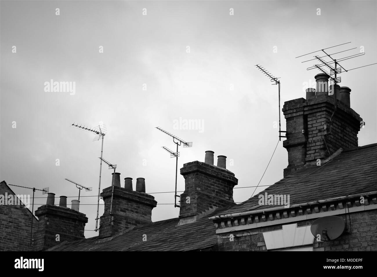 Chimney pots all in a line in black and white - Stock Image