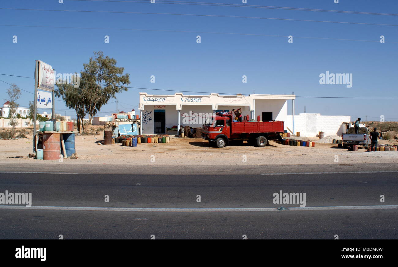 Contraband petrol smuggled from Libya for sale on southern Tunisian roadside - Stock Image