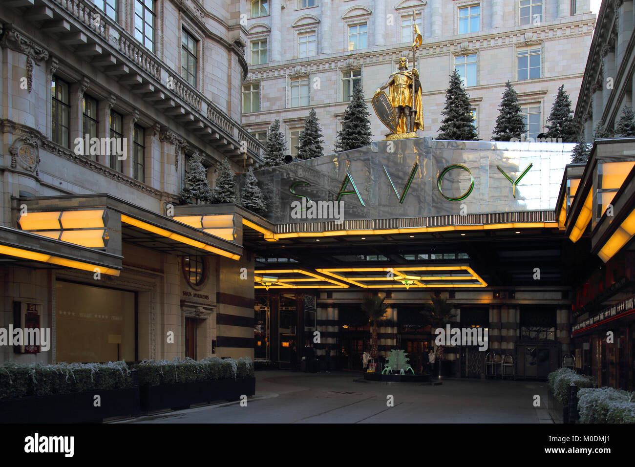 entrance to the savoy hotel off the strand london - Stock Image
