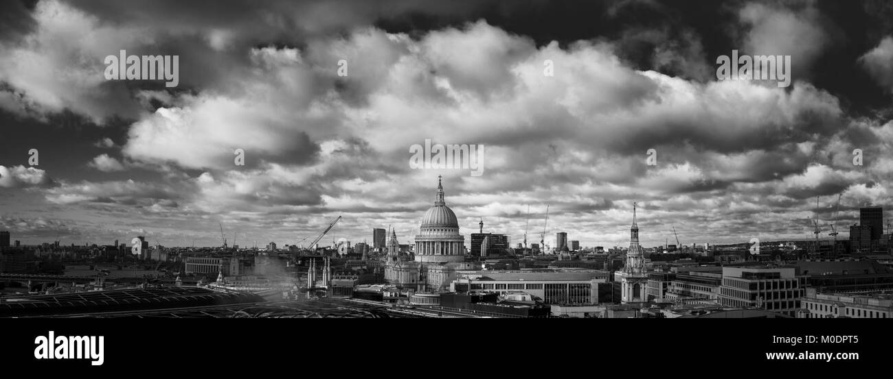 Panoramic rooftop view over London towards the landmark iconic dome of Sir Christopher Wren's St Paul's - Stock Image