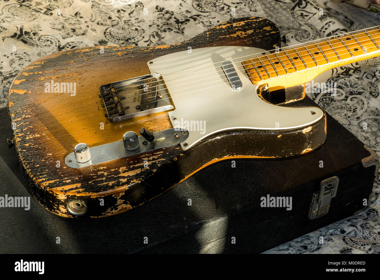 1957 Fender Telecaster electric guitar. Front of body with heavily worn 'relic' paint finish. Vintage musical instrument, - Stock Image