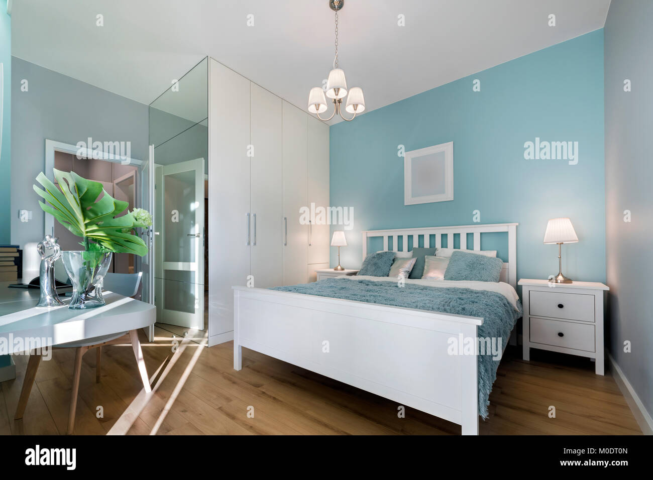 Stylish Bedroom With Mirror Wall In Pastel Colors Stock Photo Alamy