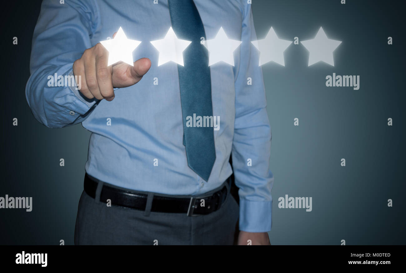 Businessman rating customer experience. stars rating system - Stock Image