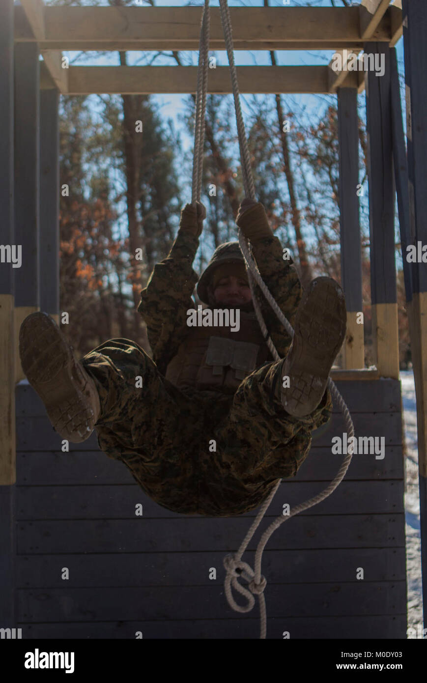 U.S. Marine Lance Cpl. Kameron V. Kraintz, a Data Systems Administrator assigned to Marine Wing Communications Squadron 48, participates in a team building exercise on the Field Leadership Reaction Course during Ullr Shield on Fort McCoy, Wis., Jan. 18, 2018. Ullr Shield is a training exercise designed to improve 2nd Marine Aircraft Wing's capabilities in extreme cold weather environments. (U.S. Marine Corps Stock Photo
