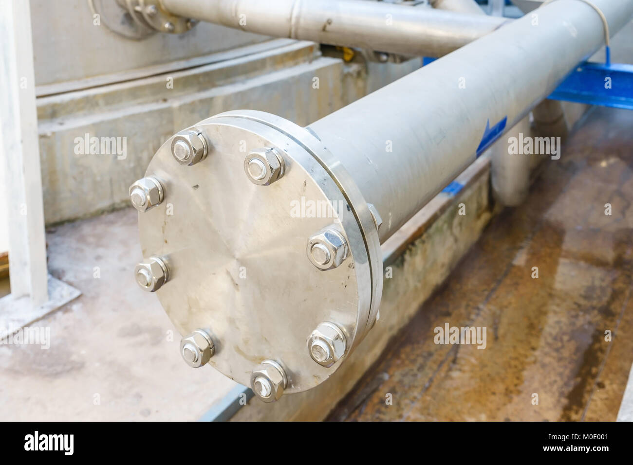 Drink water piping , Gate valves and reduction member. Pipe fittings joint with new screws and nuts. Repairing process - Stock Image