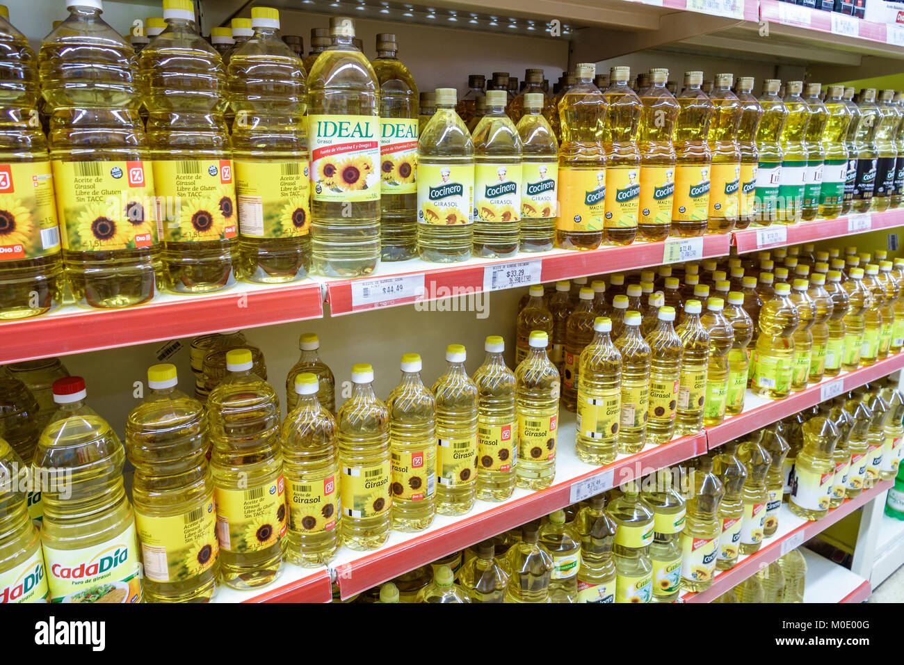 Buenos Aires Argentina San Telmo shopping interior grocery store supermarket food sunflower oil bottle shelf Hispanic - Stock Image