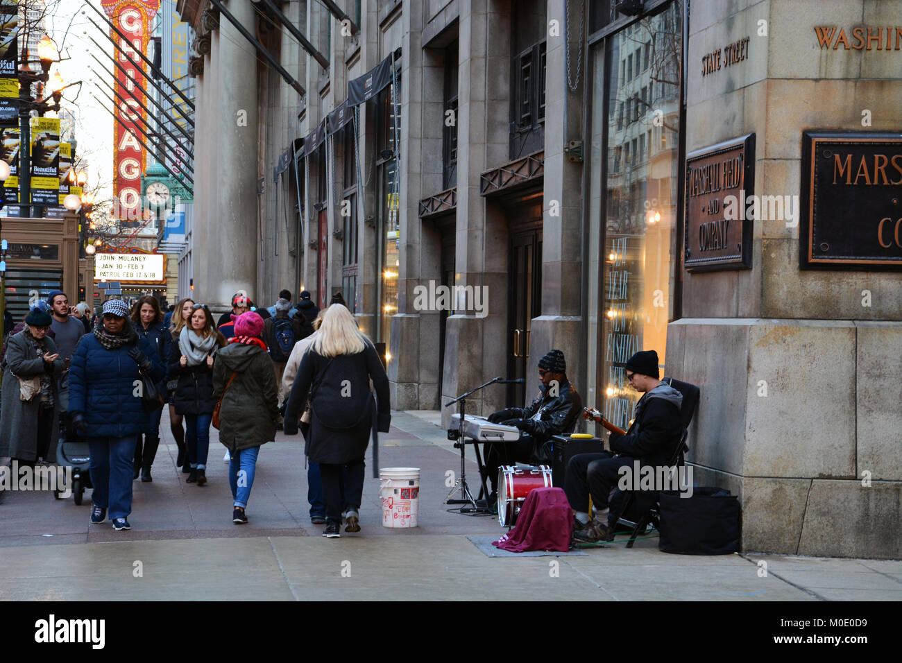 Blues street musicians take advantage of a warm and sunny winter weekend to jam on the State Street sidewalk for - Stock Image