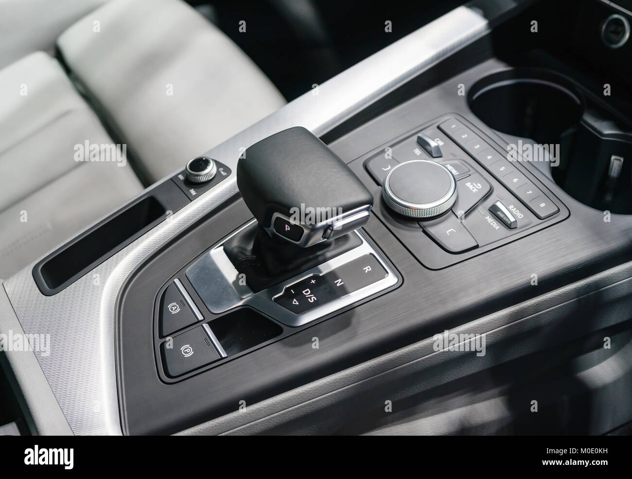 automatic gear stick of a modern car, car interior details