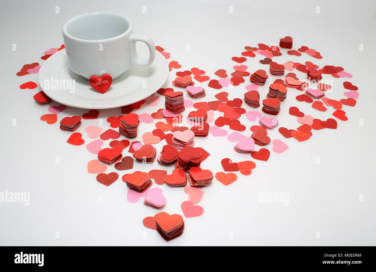 "Valentines day Heart background with i love you "" i love u "", cup of tea, hiding secret in the cup, valentine card background"