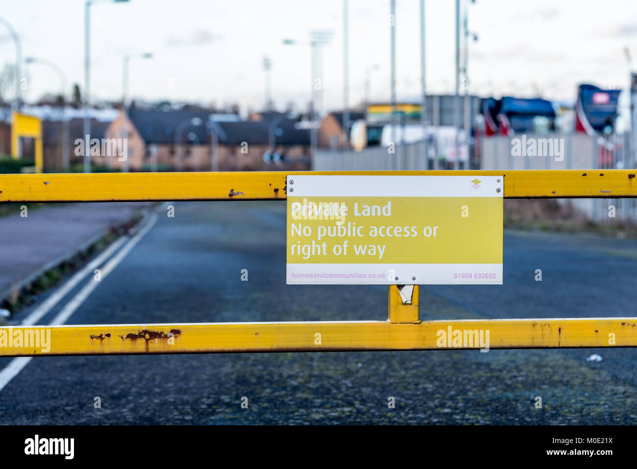 Private land no public access or right of way yellow sign on entrance gate. Stock Photo