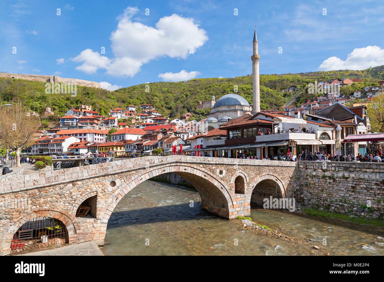 Old stone bridge and mosque in Prizren, Kosovo. Stock Photo