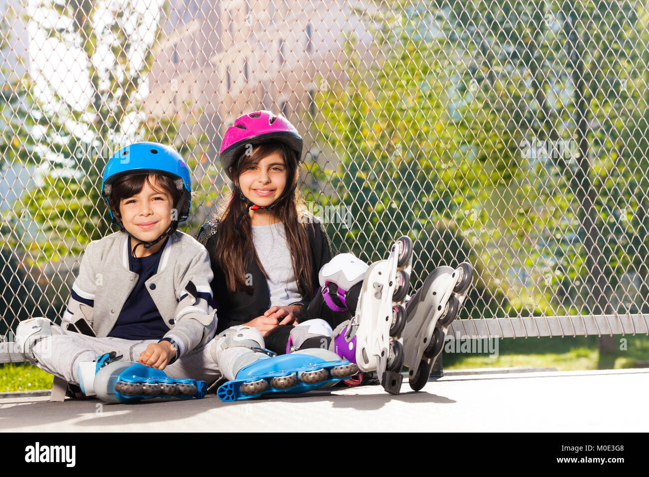 Happy preteen boy and girl in roller skates - Stock Image