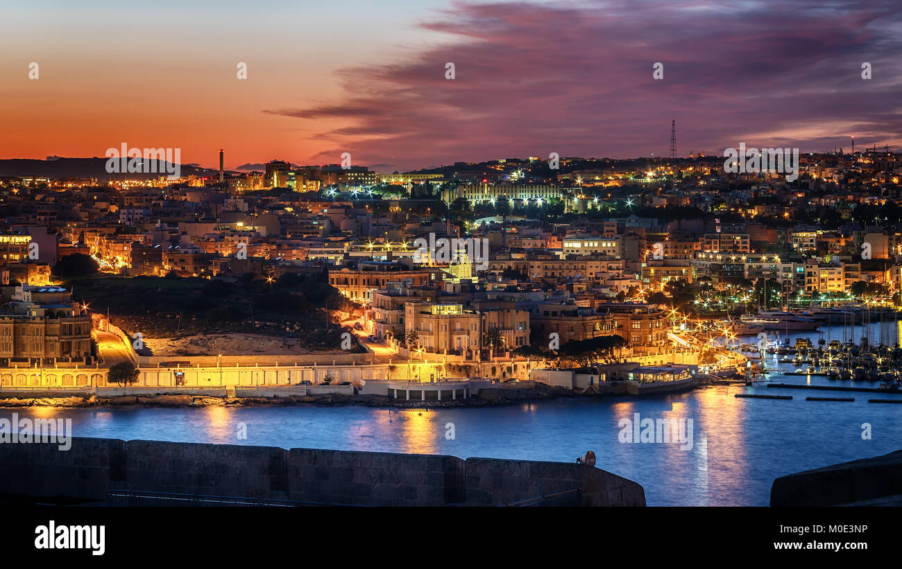 Malta: Il-Gzira and Marsans Harbour. Aerial view from city walls of Valletta at sunset - Stock Image