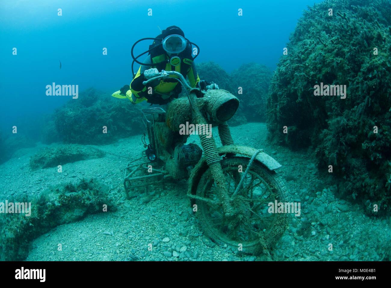 Scuba diver on a sunken motorbike, Zakynthos island,Ionian islands,  Greece, Europe - Stock Image