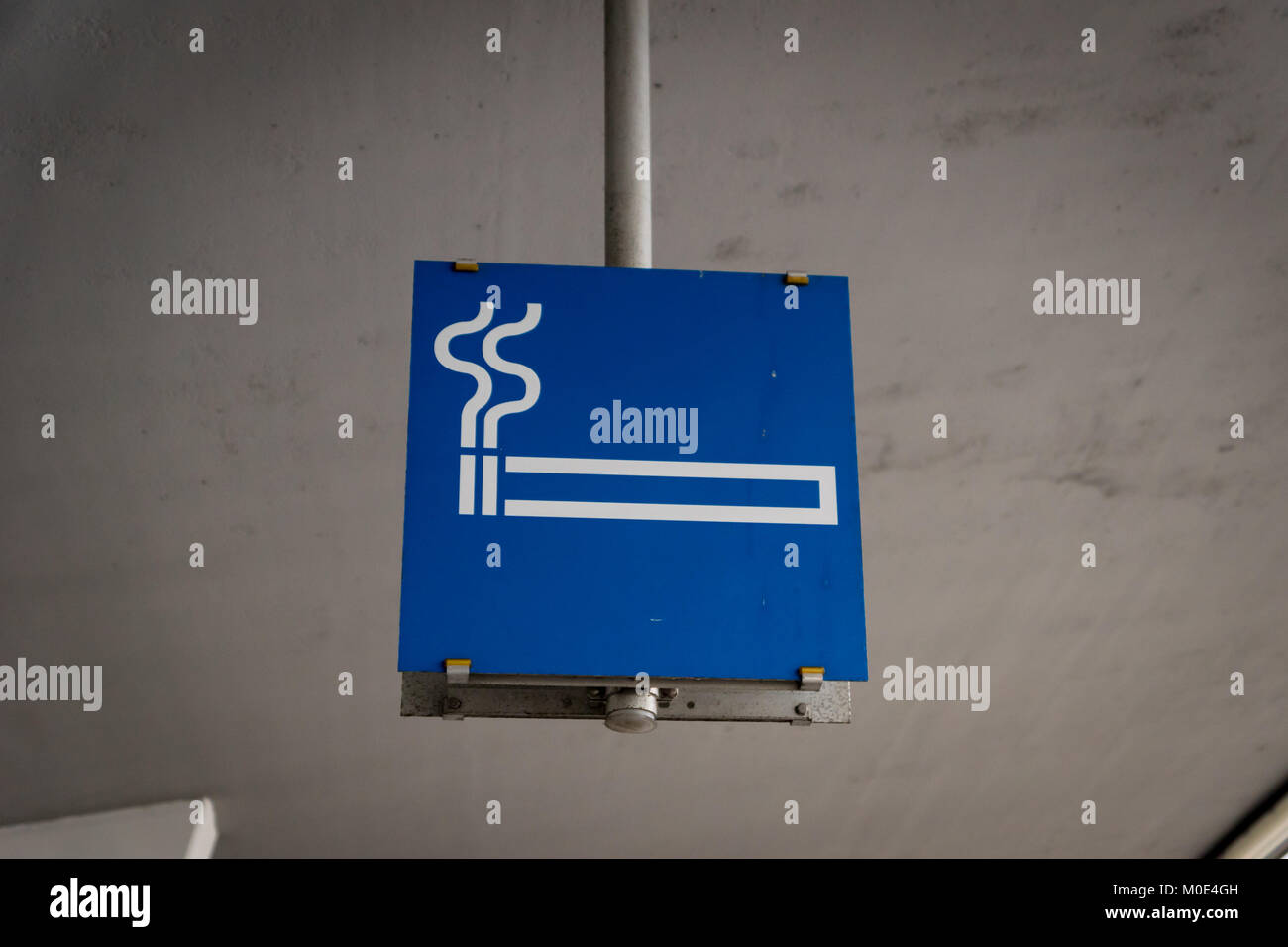 smoking cigarette area sign at airport - Stock Image