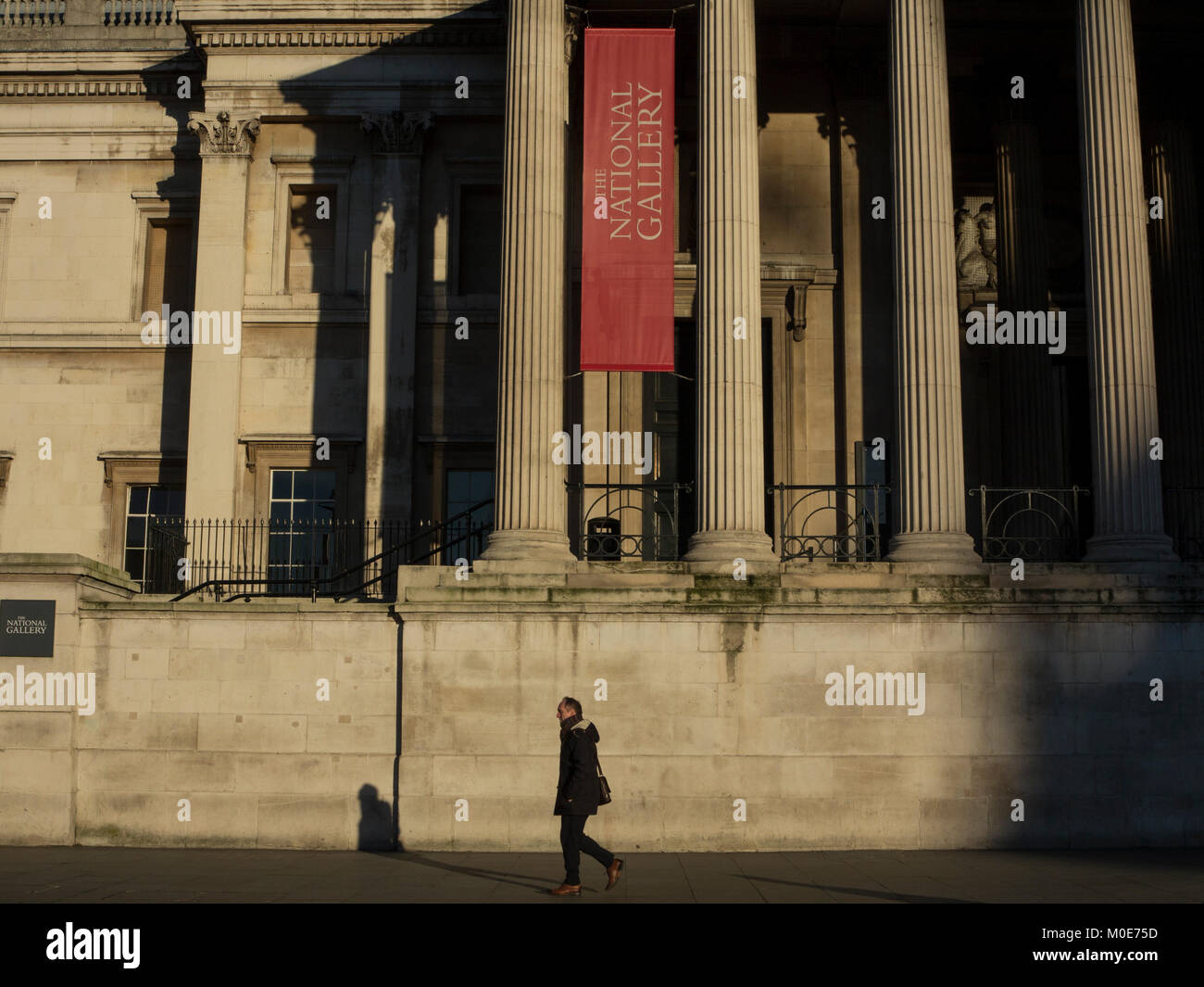 An early  morning walk in front of The National Gallery Stock Photo