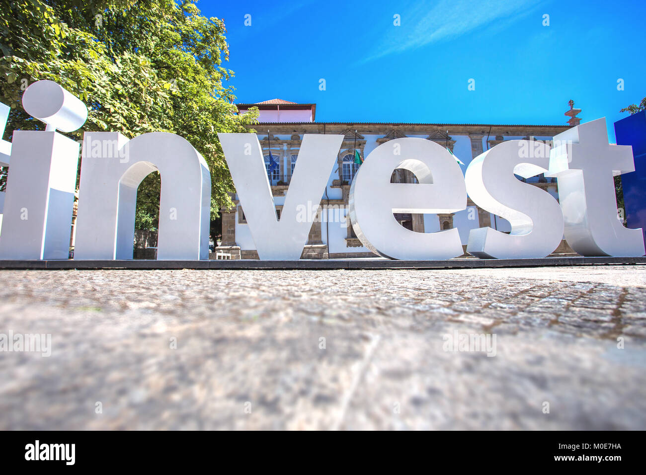 Word Invest created by big plastic letter - Stock Image