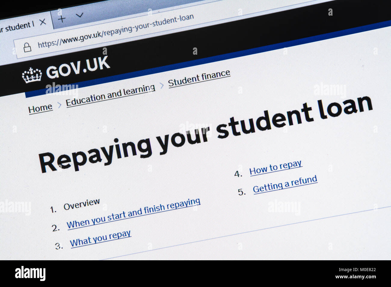Computer screenshot of information about repaying your student loan on gov.uk website - Stock Image