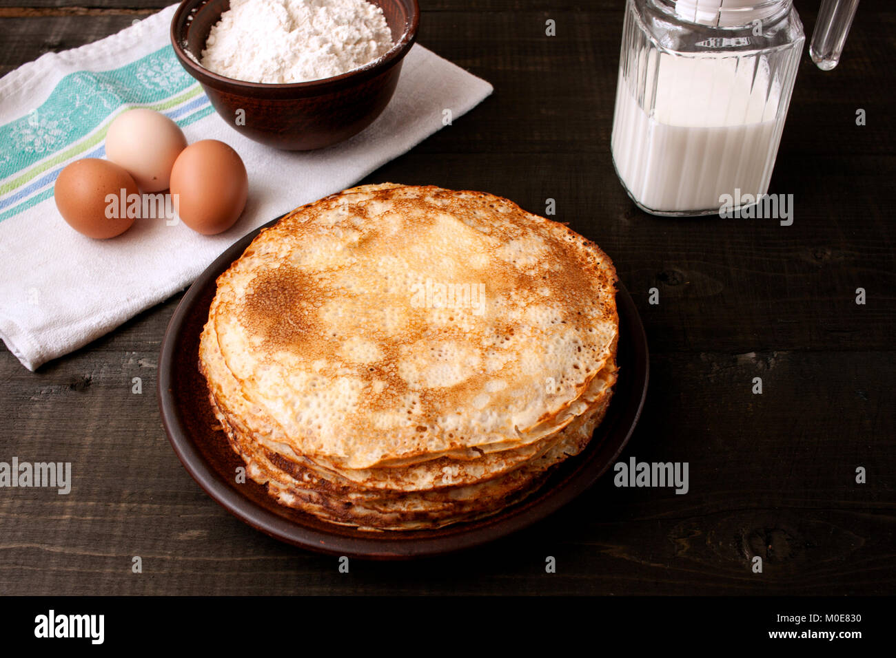Baked pancakes. Traditional cuisine for the carnival week - Stock Image