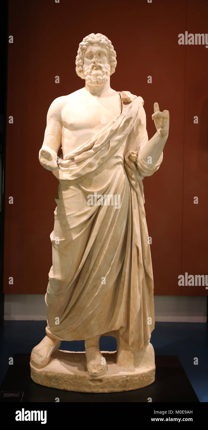 Marble sculpture of Asclepius, Greek god of medicine. 2nd century BC. Emporion, Girona, Spain. - Stock Image