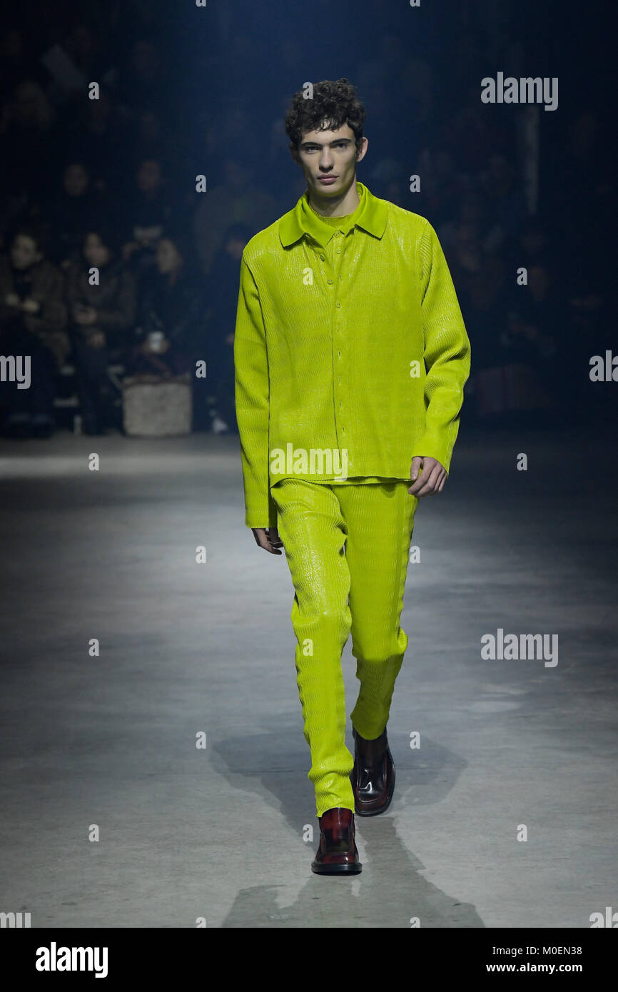 3d1683342 21st Jan, 2018. A model presents a creation of Kenzo during the men's  fashion week for 2018-19 autumn/winter men's collection in Paris, France on  Jan.