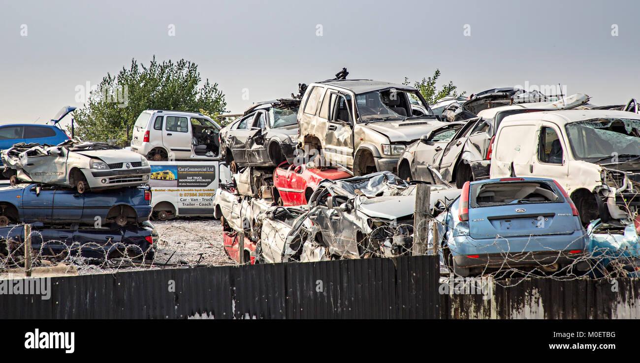 Scrap cars in breaker's yard, Flint, Flintshire, Wales, UK - Stock Image