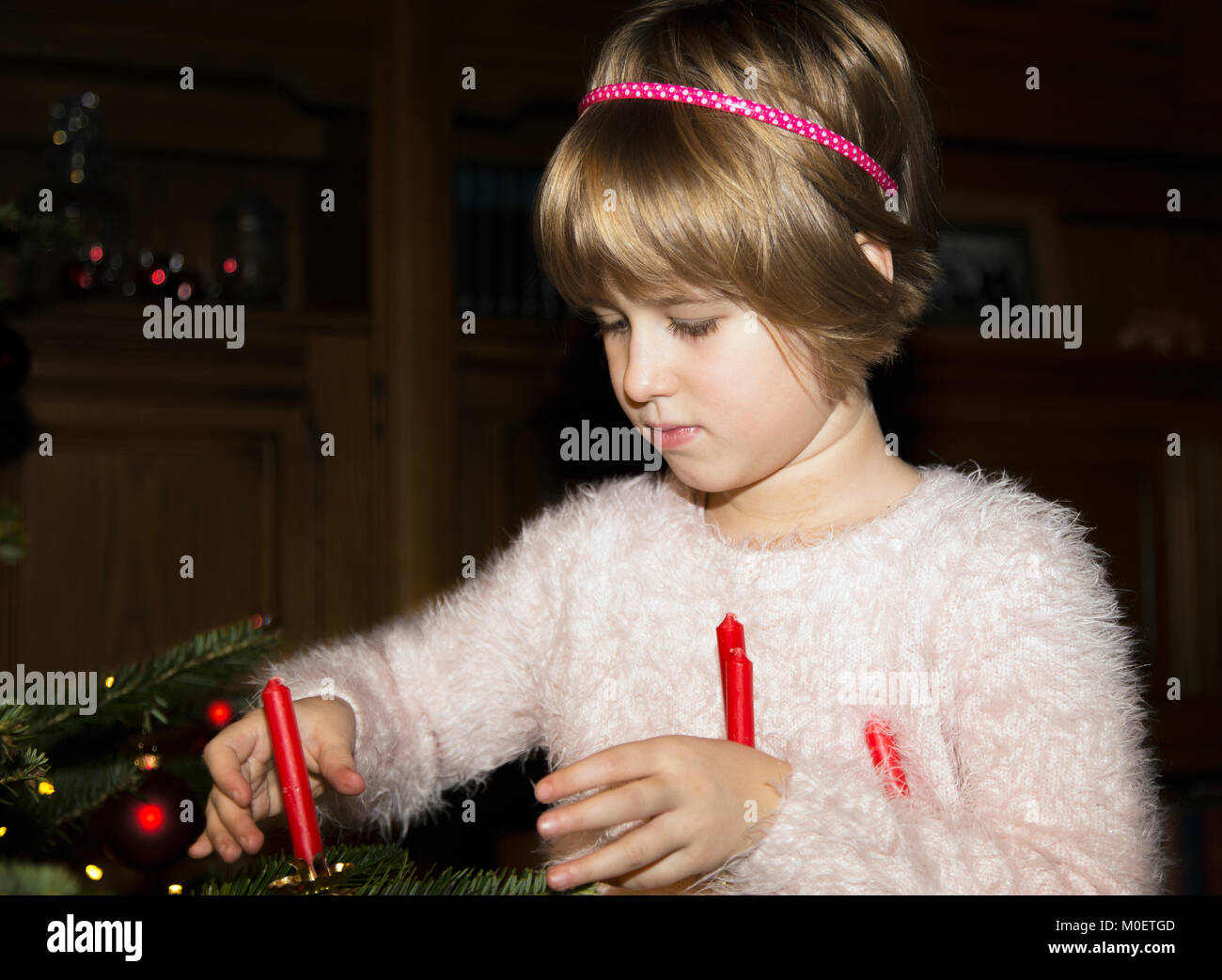 Decorating a Christmas tree - Stock Image