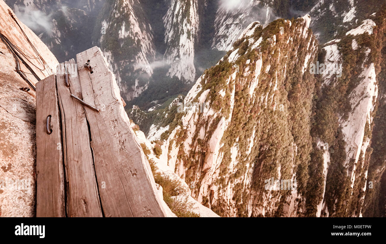 Plank trail at Mount Hua, worlds most dangerous hike, color toned picture, China. - Stock Image