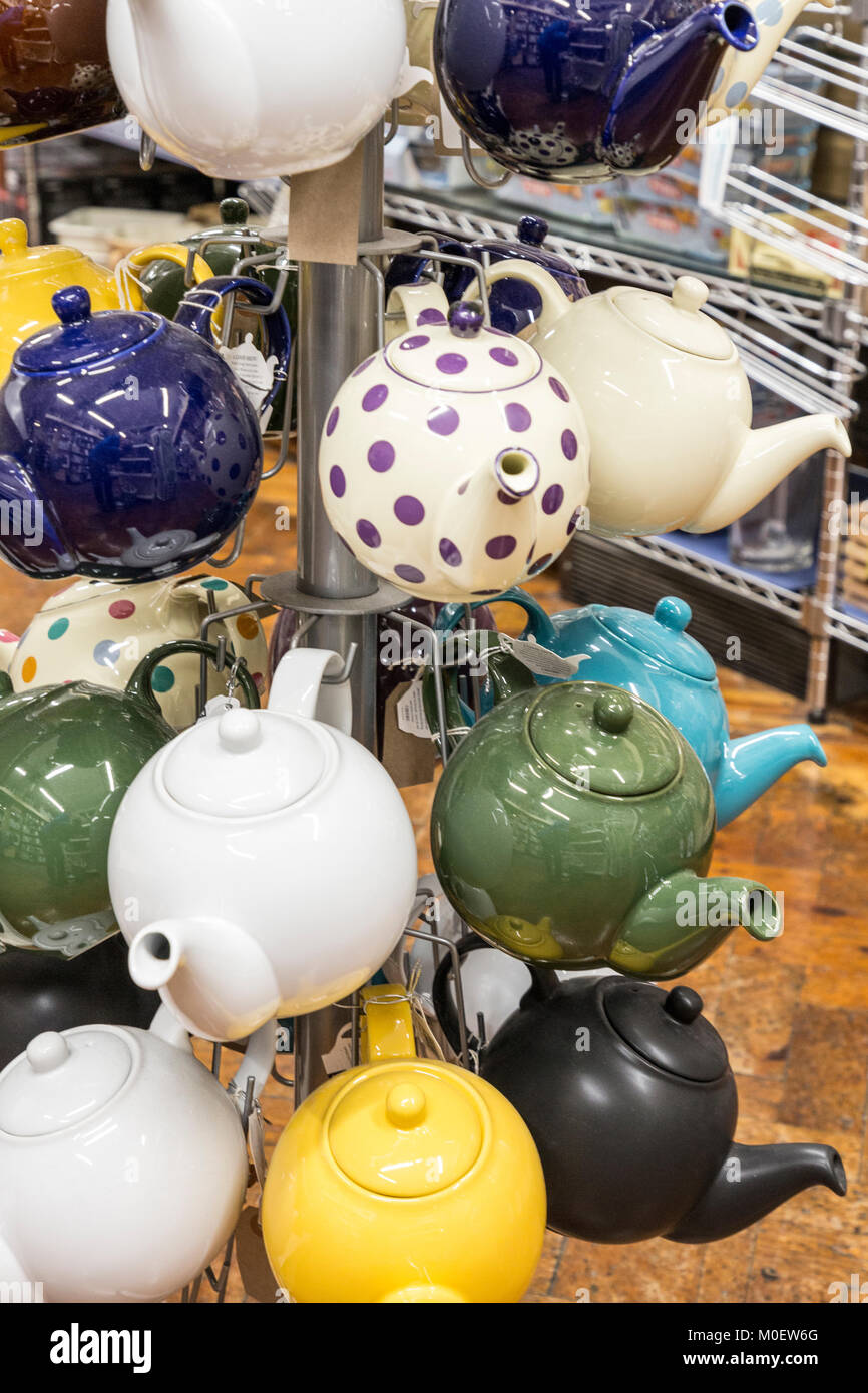 Teapots on a stand on sale in a shop, UK - Stock Image