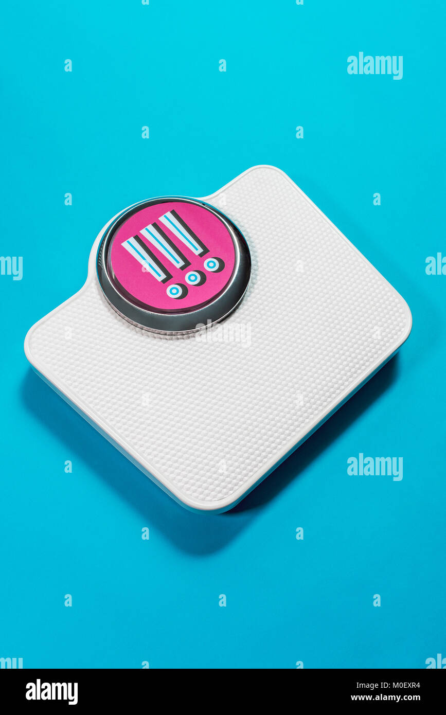 Conceptual bathroom scales with exclamation marks in the display - Stock Image