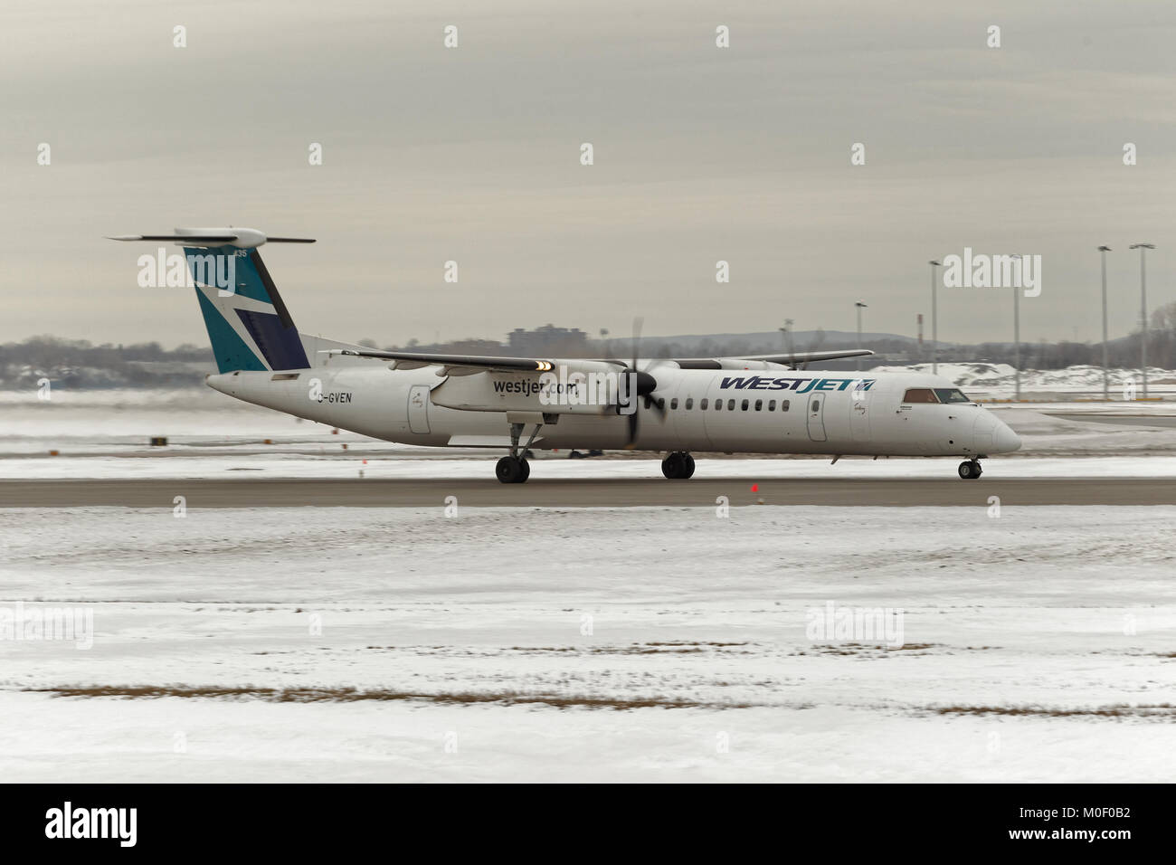 A WestJet Encore ready for take off at the YUL International airport in Dorval, Canada - Stock Image