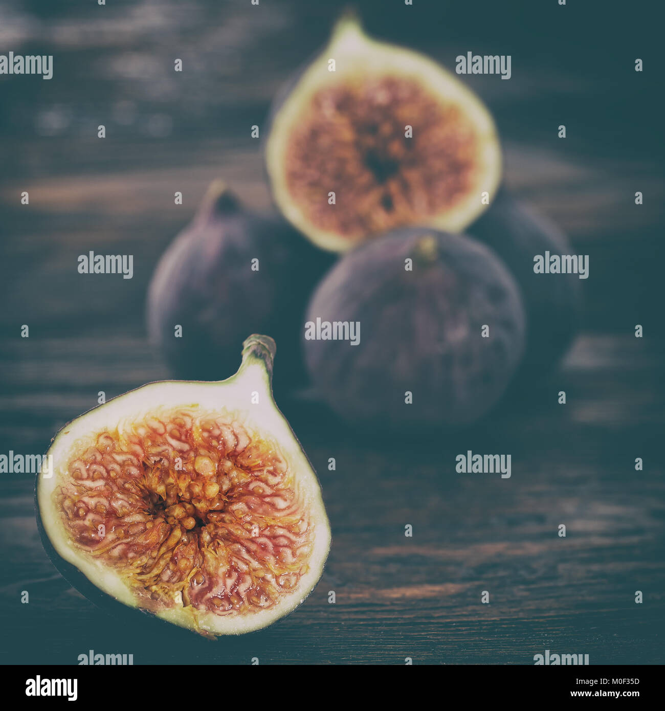 Ripe sweet figs . Healthy fig fruit on wooden table - Stock Image