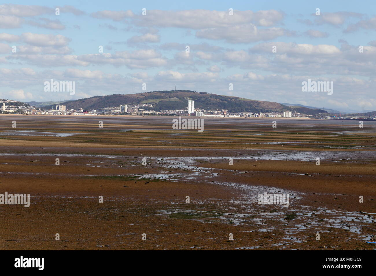 SWANSEA BAY, South Wales, UK - September 27, 2015: Swansea bay, seen here at low tide, is the proposed site for Stock Photo