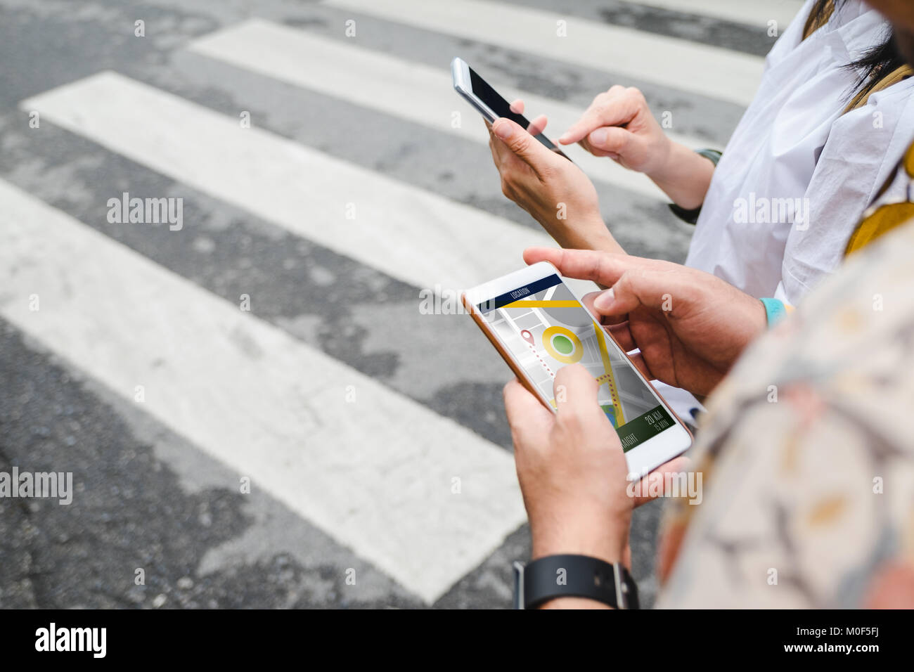 Traveler use map on mobile phone app to search for route location of place with gps on street when travel in city,Technology - Stock Image