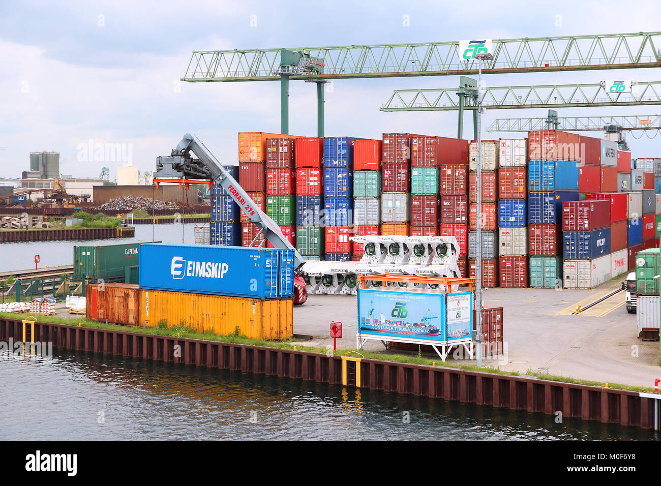 DORTMUND, GERMANY - JULY 16: Containers are loaded in Dortmund Port on July 16, 2012 in Germany. It is the largest - Stock Image