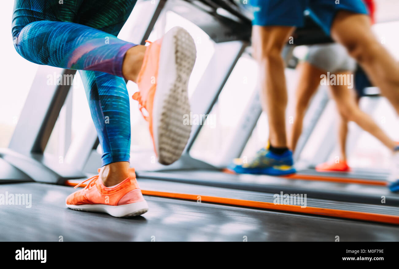 Group of friends exercising on treadmill machine - Stock Image
