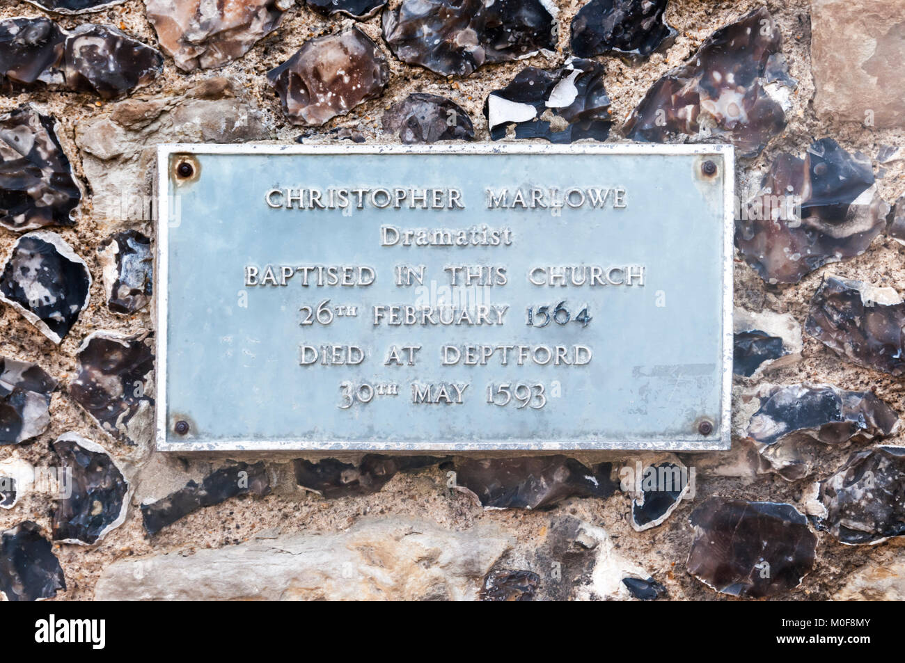 Plaque On St George's tower recording the baptism of Christopher Marlowe at the Church of St George the Martyr - Stock Image